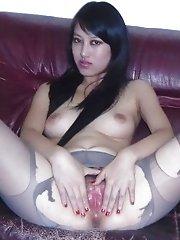 Leggy Filipina babe spreading her pussy