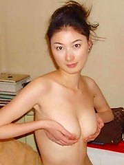 Leggy Chinese girlfriend cupping her nice tits